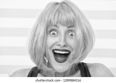 happy crazy girl with omg or wow facial expression. happy girl with crazy look. wow. surprised happy girl with orange hair. crazy look of girl saying omg. what a surprise. feeling and emotions.