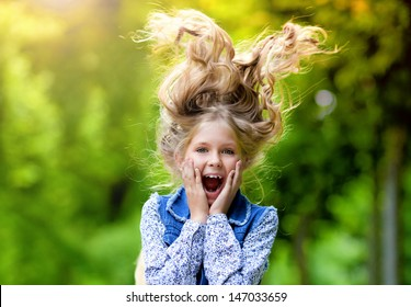 Happy crazy kid with long hair