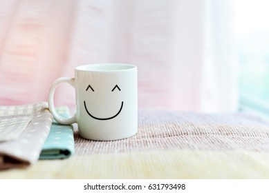Happy cup with polka dot tablecloth. Concept about happiness and waiting for someone.
