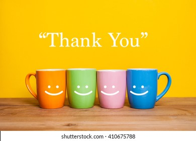 happy cups on the wood table, about Thank you concept