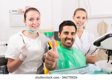 Happy cured patient in the dental clinic
