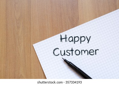 Happy customer text concept write on notebook with pen