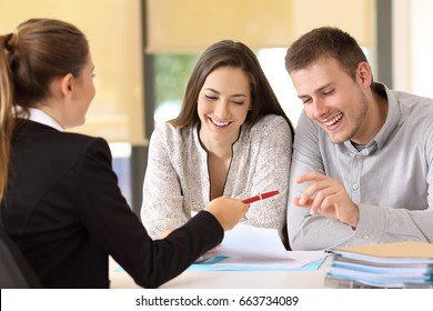 Happy customers ready to sign a contract at office