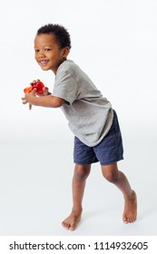Happy and cute African American boy playing his toy isolated in white background