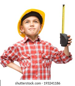 Happy cute boy as a construction worker with tape measure, isolated over white