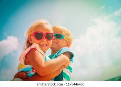 happy cute boy and girl enjoy beach