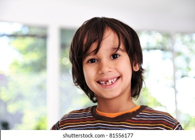 Happy cute boy without front tooth, prepared for the school