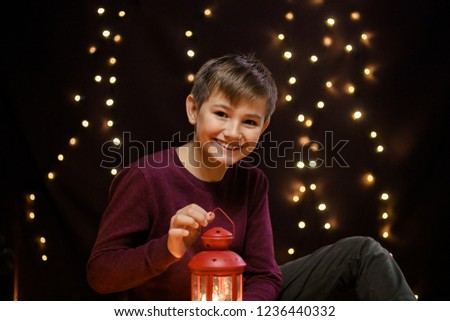 Brunette guy playing with a candle
