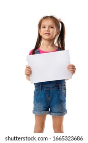 Happy cute child holding empty blank isolated on white background. kid with placard board for your text. girl with white sheet of paper. copy space