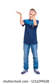 Happy cute child reaching out his palms and catching something. Full length portrait of caucasian teen boy wearing blue t-shirt. Funny teenager trying to catch something, isolated on white background