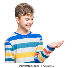 Happy cute child reaching out his palms and catching something. Half-length emotional portrait of caucasian teen boy, laughing. Funny teenager trying to catch something, isolated on white background.