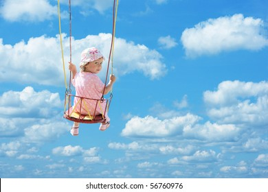 happy cute child swinging in blue summer sky, clipping path