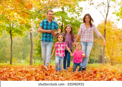 Happy cute family in the autumn October park