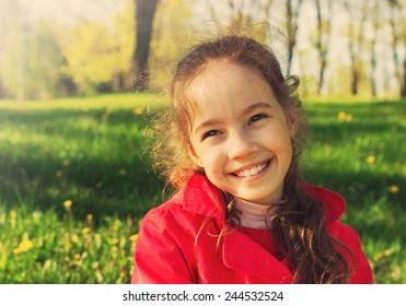 Happy cute girl having fun at sunny day