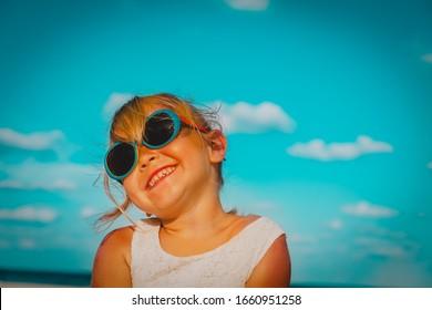 happy cute girl laugh at summer beach