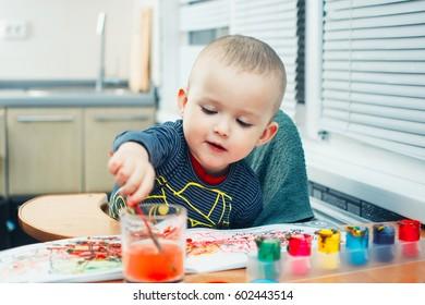 Happy cute kid paint gouache paints mixed
