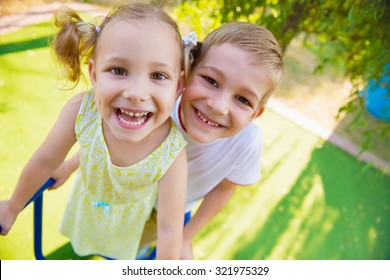 Happy cute kids having fun at playground