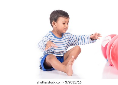 happy cute little boy play with red balloon