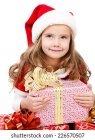 Happy cute little girl with christmas gift boxes and santa hat isolated on a white background