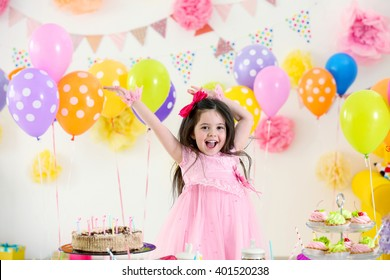 Happy cute little girl having fun at birthday party