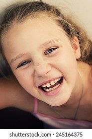 Happy cute little girl is laughing