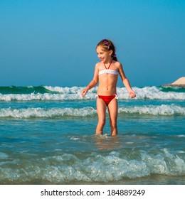 happy cute little girl on the beach