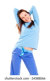 happy cute woman in blue pyjamas against white background