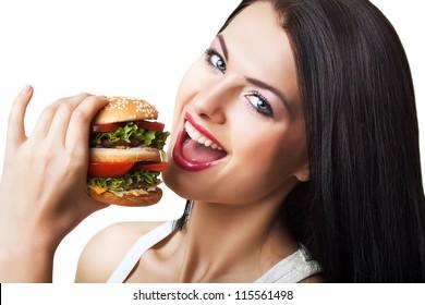 happy cute woman eating hamburger on white background