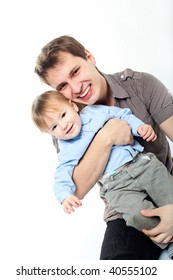 happy dad hugging his little son