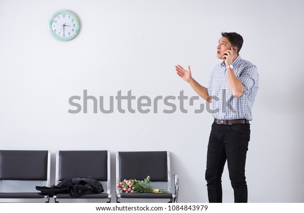 Happy dad waiting for news in maternity house
