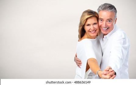 Happy dancing senior couple.