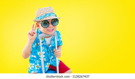 Happy Dandy Boy Hawaiian Shirt Straw Hat Ready Sitting Suitcase to Travel Dream Freedom Travel Concept Isolated Yellow Background