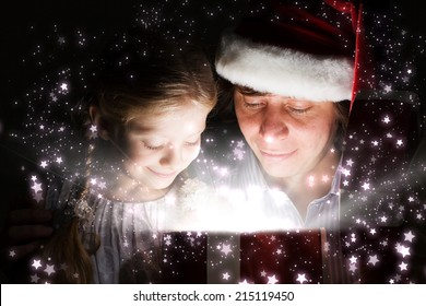 Happy daughter getting Christmas present from father