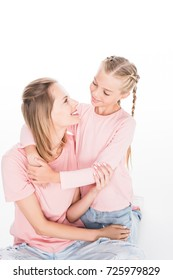 happy daughter hugging her mother, isolated on white