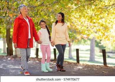 Happy daughter with mother and grandmother walking at park