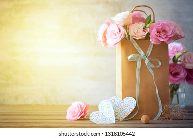 Happy Day background with pink flowers, bow and paper hearts - Love, Valentines, Wedding or Mother's day