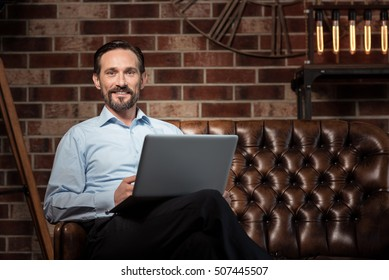 Happy delighted businessman smiling
