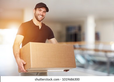Happy delivery man with box