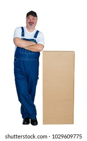Happy delivery man standing by large cardboard box against white background