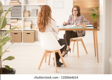 Happy dietician and patient having a conversation during an appointment