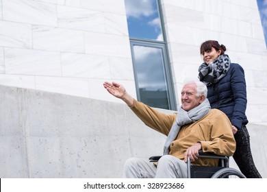 Happy disabled senior man in a wheelchair