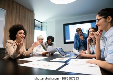 Happy diverse business colleagues meeting, working in modern office