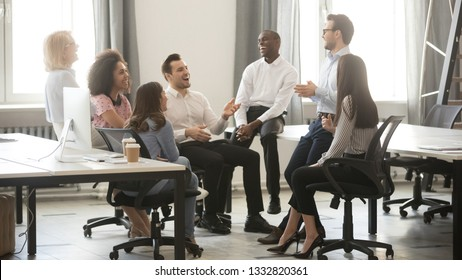 Happy diverse business team employees having fun laughing with mentor coach at corporate group meeting work break cheerful friendly multicultural office workers interns joking at briefing training