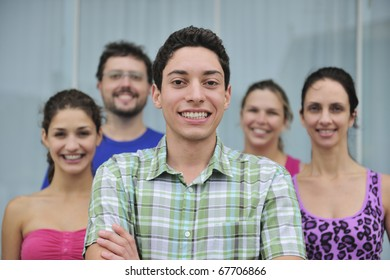 happy and diverse group of casual real people, young man in front