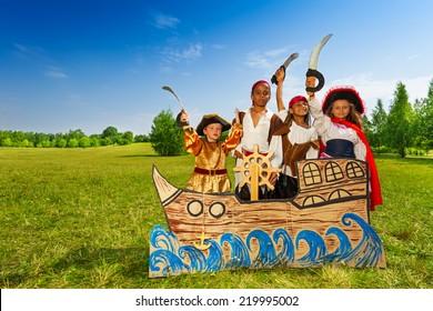 Happy diversity children as pirates with swords