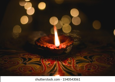 Happy Diwali - clay diya lamp lit during dipavali.