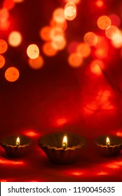 Happy Diwali - Clay Diya lamps lit during Dipavali, Hindu festival of lights celebration