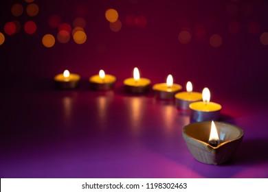 Happy Diwali  Clay Diya lamps lit during Dipavali, Hindu festival of lights celebration