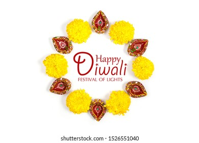 Happy Diwali - Clay Diya lamps lit during Dipavali, Hindu festival of lights celebration. Colorful traditional oil lamp diya on white background. Copy space for text.