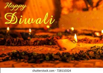 Happy Diwali Diya flame on glass of water on diwali festival of lights